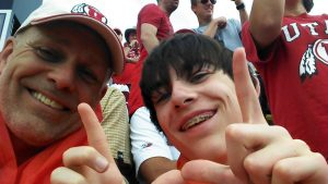 Larry and son, Connor, at Utah vs. Michigan in Ann Arbor last fall.